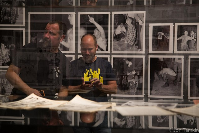 Dave from 1982 is reflected in the glass over Dave of 2012, with Larry Eberhard