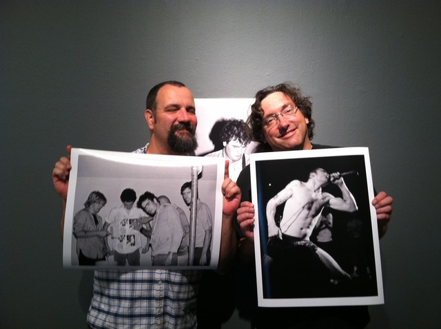 Dave Markey & Jordan Schwartz with a couple of their images. D. Boon on wall