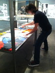 Bazillion Points' Ian Christe helps out prior to the opening